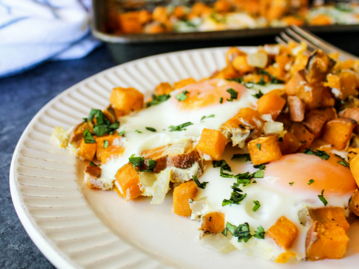 Sheet Pan Sweet Potato Hash & Eggs plated by The Whole Cook