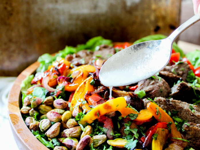 Southwestern Steak Salad with Lime Vinaigrette dressing pour horizontal by The Whole Cook